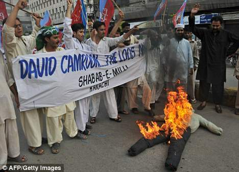 An effigy of David Cameron burns in the streets of Karachi